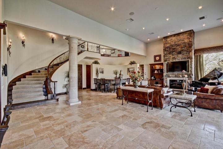 Curved staircase leading upstairs to an entertainment loft of approx. 1084 s.f. with theater room and