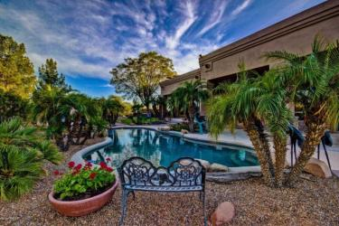 Amazing backyard with dramatic pebble finish heated pool & spa, water features, outdoor kitchen with integrated BBQ and fire pit with rock seating.