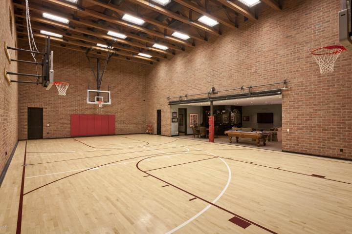 3 9m scottsdale crib features an indoor basketball court for Home plans with indoor sports court