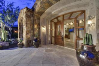 Block construction with all natural stone exterior home in Whisper Rock 1