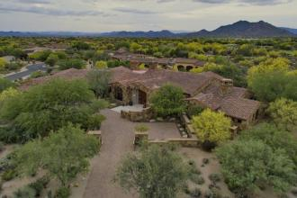 Block construction with all natural stone exterior home in Whisper Rock 2