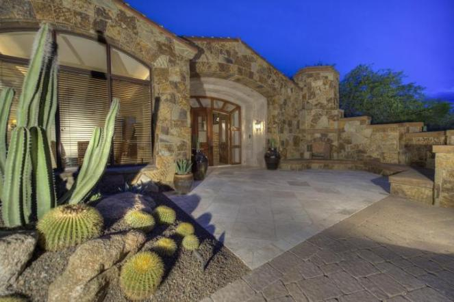 Block construction with all natural stone exterior home in Whisper Rock 3