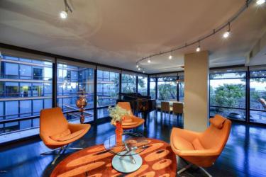 6th floor Optima Biltmore Towers pad has huge terrace, wine lovers dream 2