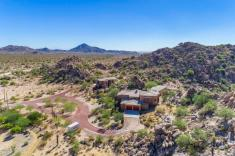 $1.4M Off the grid multi-level estate with guest house is a luxurious retreat and has forever views